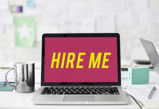 "Featured image for the ""8 Websites to Find Freelance Jobs in Singapore (Apart From Gumtree, JobStreet etc...)"" post. It features a Macbook with the words ""HIRE ME"" on its screen."