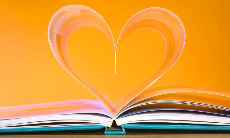"Featured image for the ""9 Ways Media Freelancers Can Claim Free Money for Skills Upgrading"" post. It features book pages curled up in the shape of a heart."