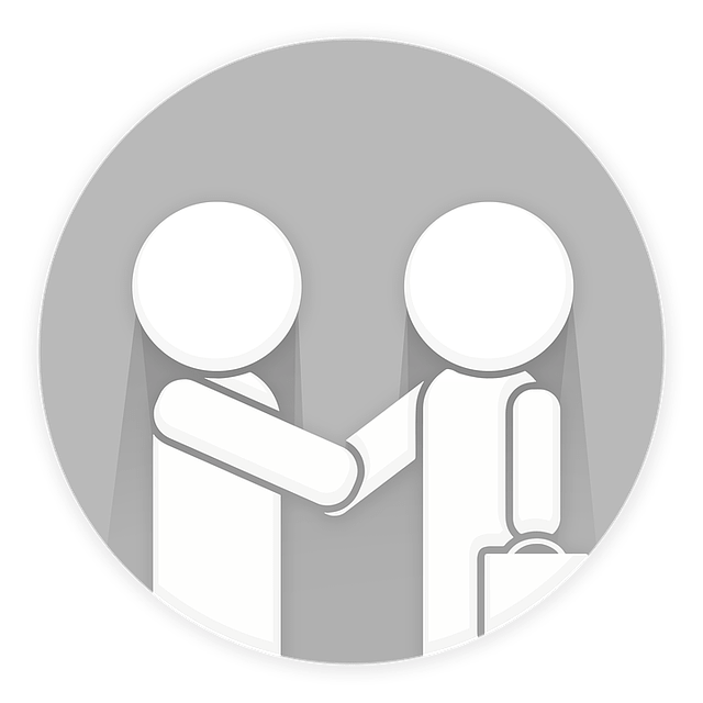Two stick figures (one of whom holding a briefcase) shaking hands with each other