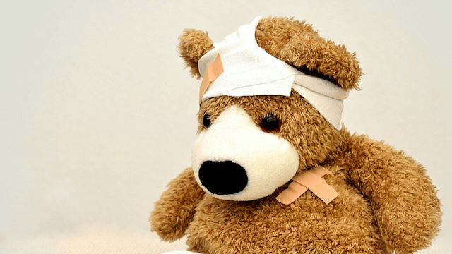 Teddy bear with bandage around its head