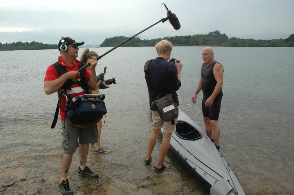 Nick's crew filming at a beach in Indonesia for History Channel as he handles the sound recording