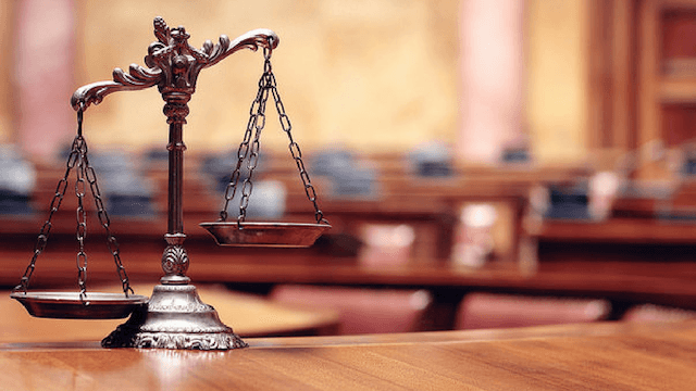 A set of balance scales in a courtroom