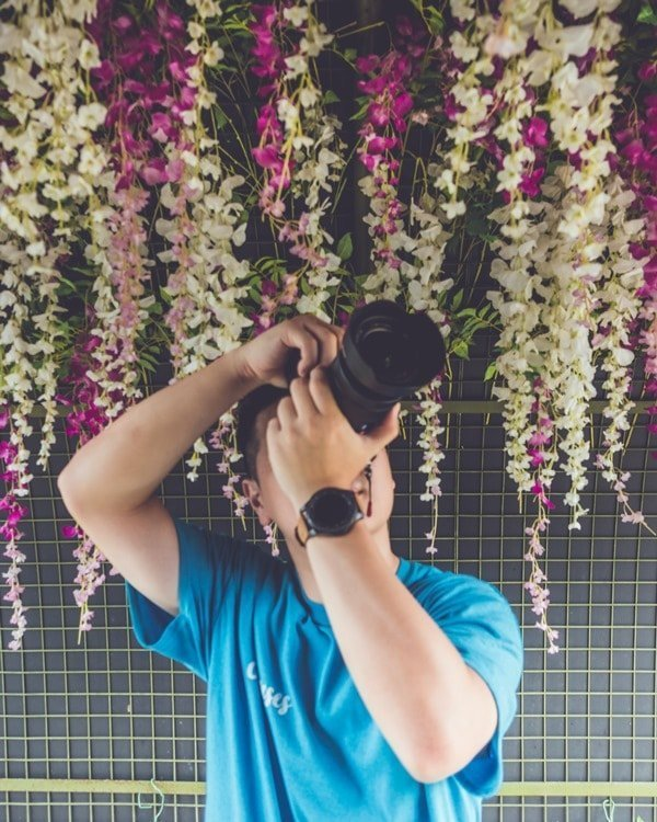 James Teo taking a photo of something above him