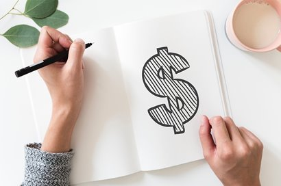 Notebook with a dollar sign drawing