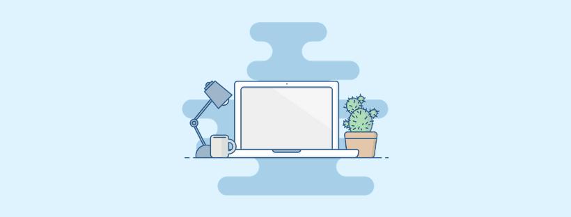 Laptop, desk lamp and cactus pot