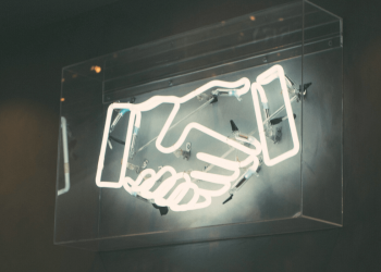 Neon lights in the shape of a handshake